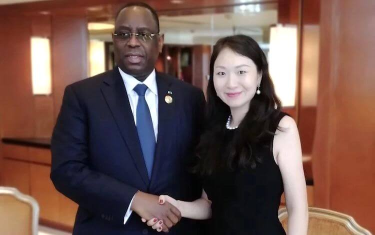 Helen Hai with the president of Senegal, Macky Sall