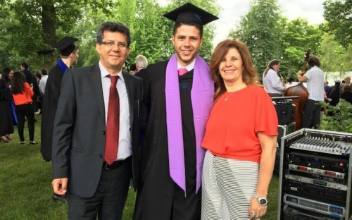 Vincent (center, with parents) graduated with an MBA from France's HEC Paris in 2016