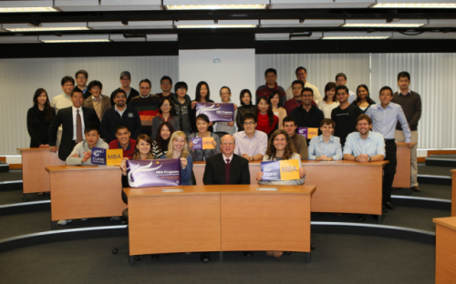 Michael J. Ferguson, Associate Dean and Director, MBA Programmes with MBA students celebrating CUHK ranking 28th in the Financial Times 2012 global full-time MBA rankings