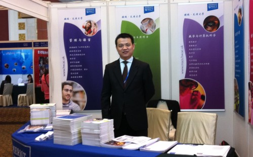 Heriot-Watt University's Zhongyi Wang at an education fair in Asia
