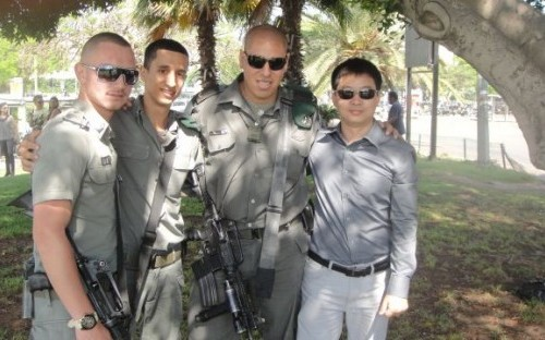 Reynold blending in with the Israeli Army Officers