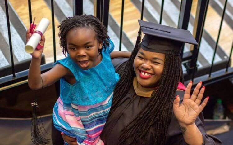 MBA mom, Divinity Matovu, graduated from Wharton with her daughter by her side