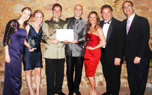 "WINNING SMILES – CEIBS students Eric Seidner (3rd left) and Rober Seiler (4th left) pose with their certificate after winning the ""Responsible Leadership Award and Grant"" at the 2011 Global Business Forum"